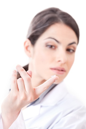 Optometrist holding contact lens in finger  photo