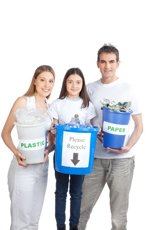 Portrait of happy couple smiling with daughter holding recycle bin  photo