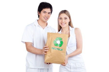recycle bag: Portrait of young happy couple holding paper bag