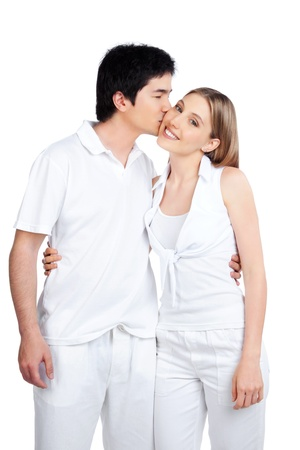 Portrait of young man kissing the young woman isolated on white background  photo