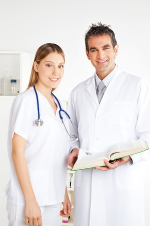 general knowledge: Portrait of happy smiling female and male doctor