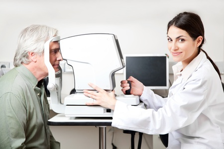 Optometrist taking an eyesight test examination  Stock Photo