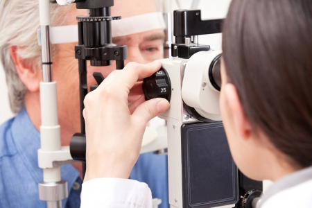 ophthalmic: Optometrist doing sight testing for pateient  Stock Photo