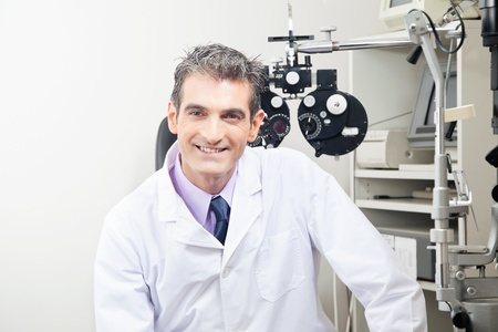 optometrist: Portrait of doctor in ophthalmology clinic