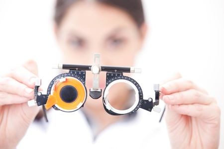 eye care professional: Optometrist holding a eye test glasses  Stock Photo
