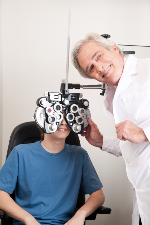 Optometrist doing sight testing for pateient  Stock Photo - 13871967