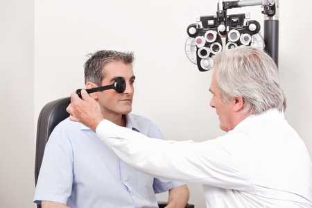 check up: Man taking an eyesight test examination