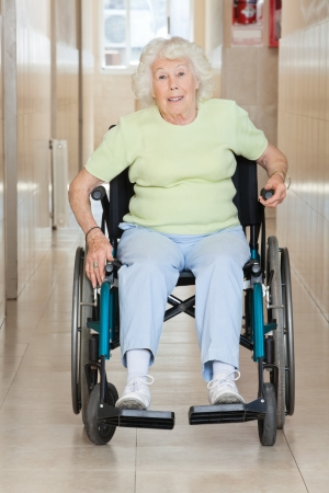 Full length portrait of a senior woman sitting in a wheel chair photo