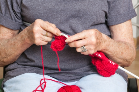 Mid section of senior woman knitting Stock Photo - 14031744