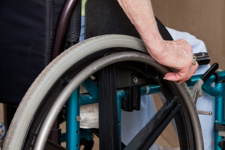 medical equipment: Close-up of Elderly Woman s Hands on wheelchair  Stock Photo