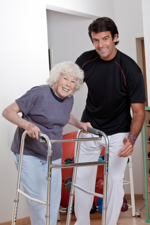 walkers: A therapist assisting a senior woman onto her walker