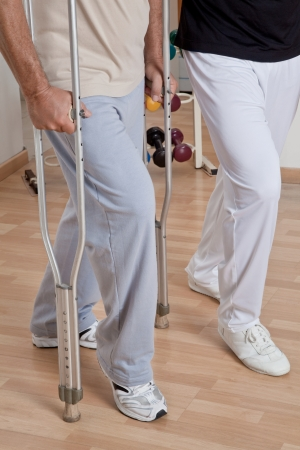 Patient on crutches discusses his progress  photo
