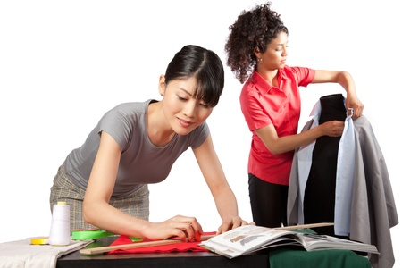 Two young woman dressmaker at work  photo