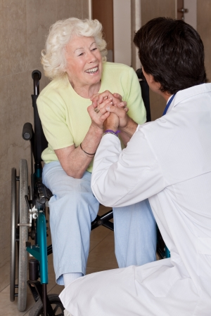 Doctor with patient on wheel chair at hospital  photo