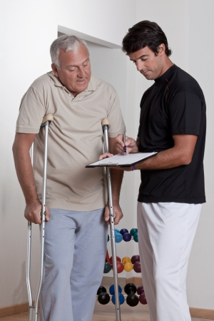 crutches: Patient on crutches discusses his progress