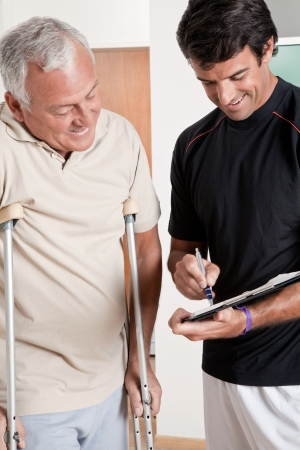 physical therapist: Patient on crutches discusses his progress