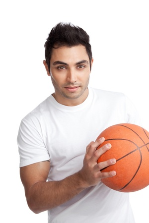 Portrait of young man holding basketball isolated on white background  photo