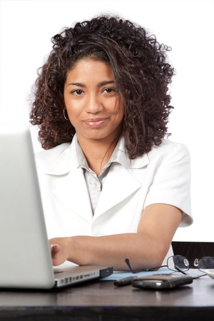 Portrait of female doctor using laptop at work isolated on white background  photo
