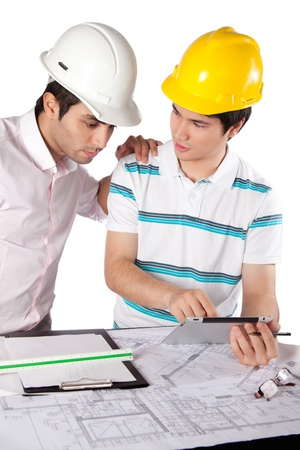 Two architects using digital tablet at work isolated on white background  photo