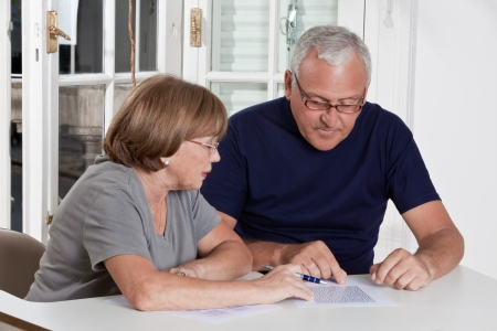 Portrait of mature couple playing scrabble game  photo