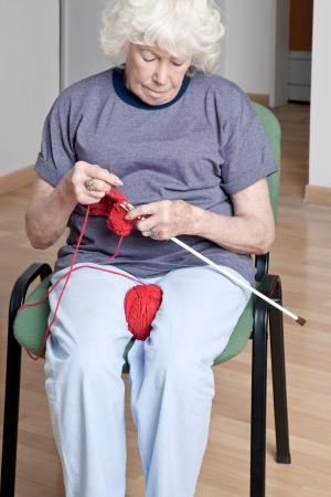 close knit: Portrait of a senior woman knitting