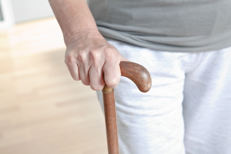 Close-up of elderly woman with walking stick  photo