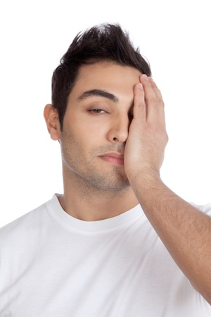 Young stressed man with hand on his face isolated on white background  photo
