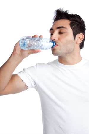 man drinking water: Portrait of young man drinking water from bottle isolated on white background