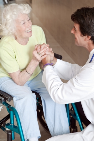 consoling: Doctor with patient on wheel chair at hospital  Stock Photo
