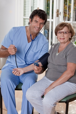 Doctor taking the blood pressure of a patient  photo