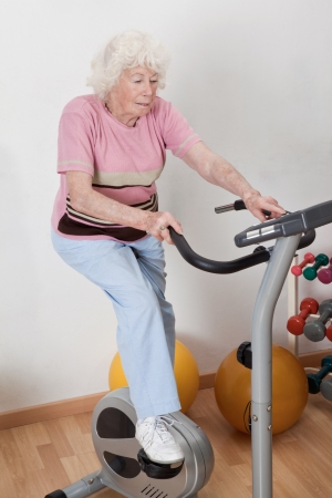 Portrait of senior female doing physical exercise   photo