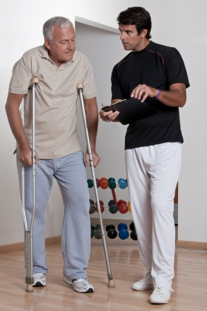 physiotherapist: Patient on crutches discusses his progress
