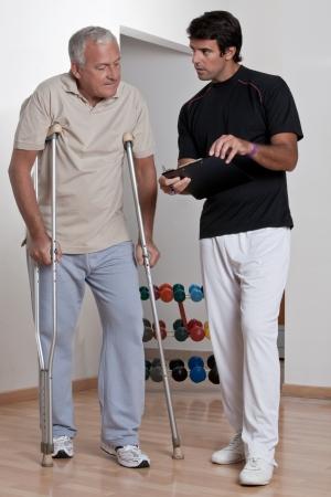 Patient on crutches discusses his progress Stock Photo - 14350848