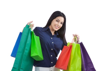 Close-up of happy young woman holding shopping bags isolated on white background  photo