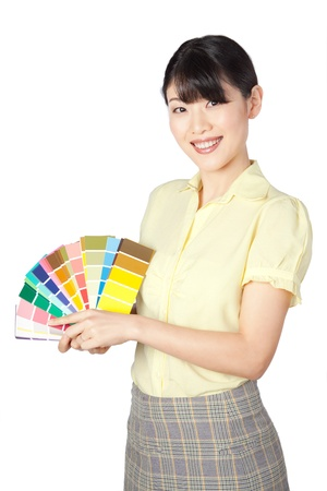 color chart: Happy young woman  showing color chart isolated on white background  Stock Photo