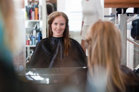 Women looking in mirror at beauty salon  photo