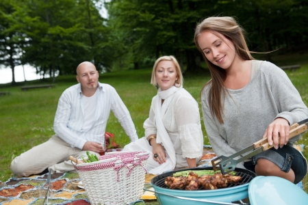 ing: A group of friends bbq ing in the park Stock Photo