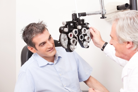 optician: Optometrist doing sight testing for pateient  Stock Photo