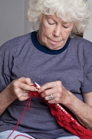Portrait of a senior woman knitting  photo