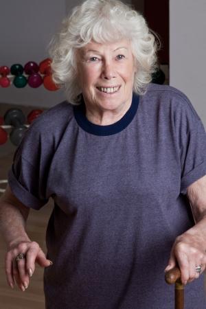 Portrait of senior woman with walking stick  photo