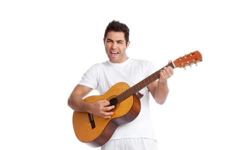 playing the guitar: Portrait of young man playing guitar isolated on white background  Stock Photo