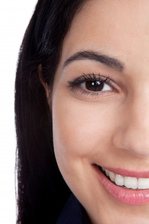 美しい女性の顔が白い背景で隔離のクローズ アップ 写真素材