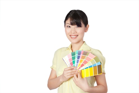 Happy young woman  showing color chart isolated on white background  photo