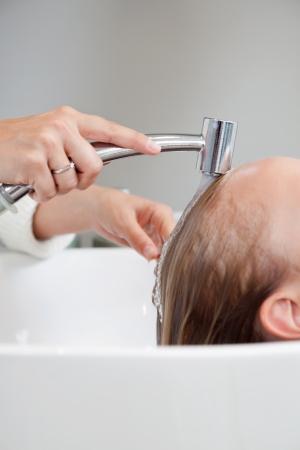 Cropped image of beautician washing hair of female customer at beauty salon Stock Photo - 14454648