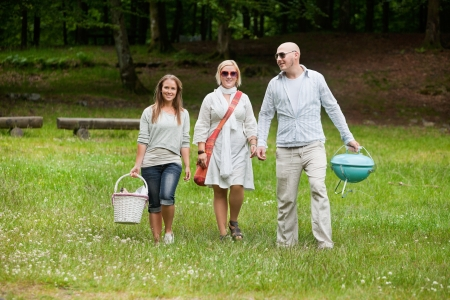 leisureliness: Full length portrait of group of friends out for a bbq picnic
