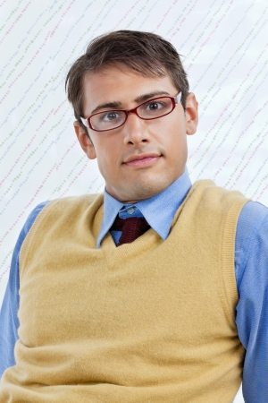 Portrait of smart young male business executive wearing eyeglasses over textured background Stock Photo - 15190810