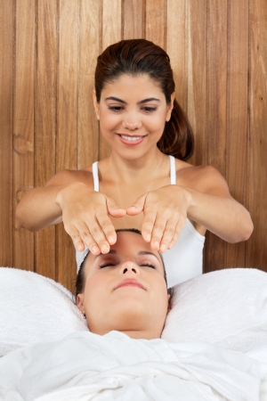Young woman receiving massage from a female masseur at health spa Stock Photo - 15191005