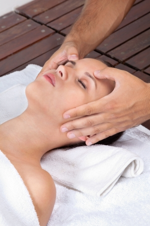 Beautiful young female receiving head massage by a male masseuse at health spa Stock Photo - 15190920