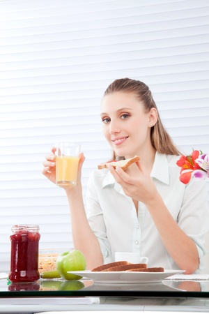 Young woman having healthy breakfast   photo