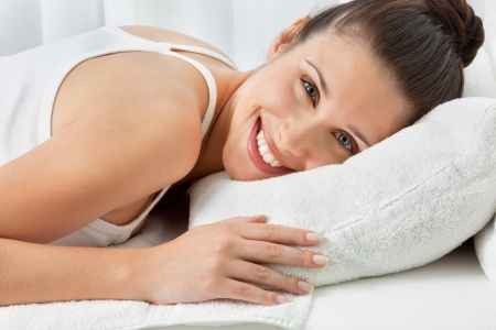 Portrait of happy young woman relaxing at health spa Stock Photo - 14937779